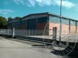 Immagine di Capannone industriale con magazzino, laboratorio, zona uffici ed area cortiliva in Gualtieri (RE)