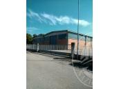 Capannone industriale con magazzino, laboratorio, zona uffici ed area cortiliva in Gualtieri (RE)